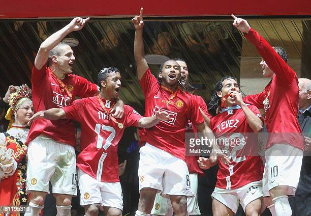 Nemanja Vidic Nani Anderson Carlos Tevez and Wayne Rooney of Manchester United celebrate after winning the UEFA Champions League Final match between...