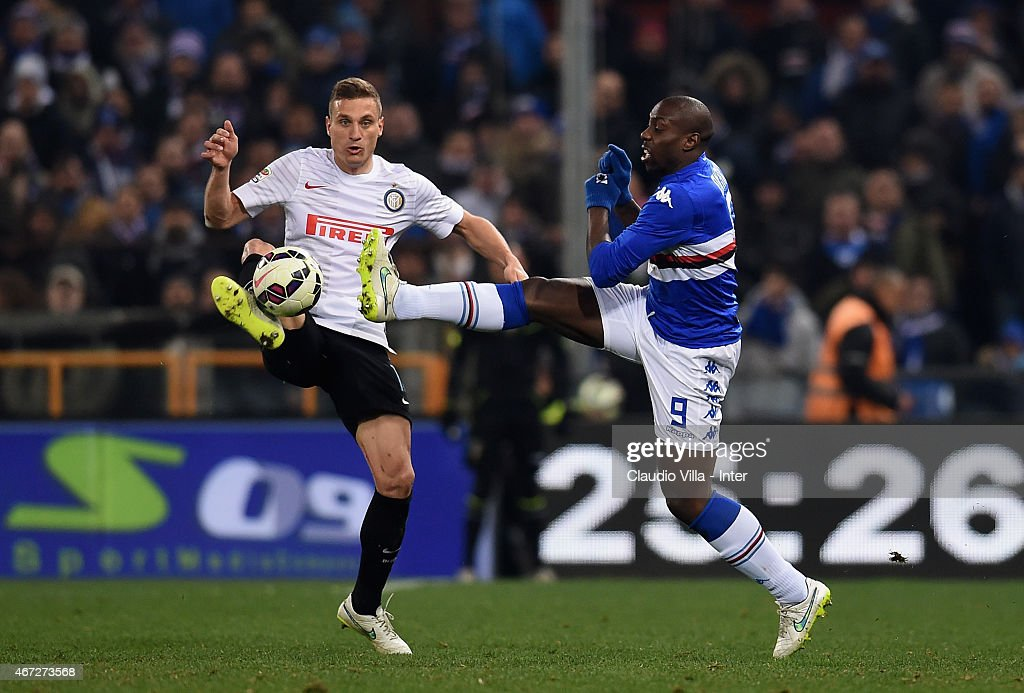 Nemanja Vidic of FC Internazionale (L) and Stefano Okaka of UC Sampdoria compete for the ball during the Serie A match between UC Sampdoria and FC Internazionale Milano at Stadio Luigi Ferraris on March 22, 2015 in Genoa, Italy.