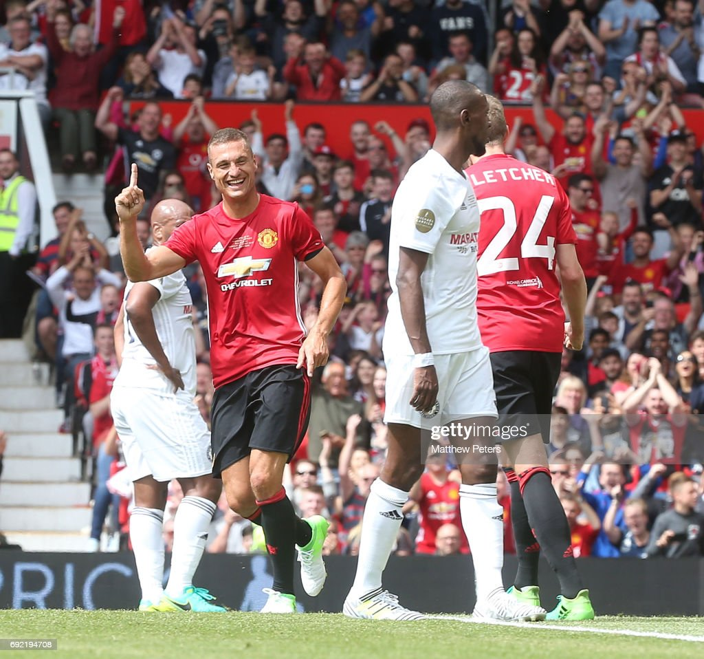 Nemanja Vidic of Manchester United '08 XI celebrates scoring their first goal during the Michael Carrick Testimonial match between Manchester United '08 XI and Michael Carrick All-Stars at Old Trafford on June 4, 2017 in Manchester, England.