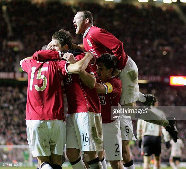 Nemanja Vidic of Manchester United celebrates scoring the second goal during the UEFA Champions League match between Manchester United and Benfica at...