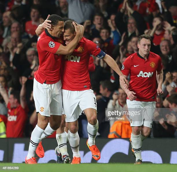 Nemanja Vidic of Manchester United celebrates scoring their first goal during the UEFA Champions League quarterfinal first leg match between...