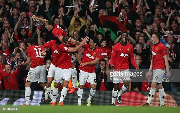 Nemanja Vidic of Manchester United celebrates scoring their first goal during the UEFA Champions League quarterfinal first leg match between...