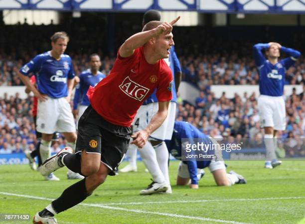 Nemanja Vidic of Manchester United celebrates scoring their first goal during the Barclays FA Premier League match between Everton and Manchester...