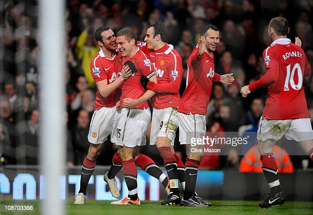 Nemanja Vidic of Manchester United celebrates with his team mates after scoring his team's third goal during the Barclays Premier League match...