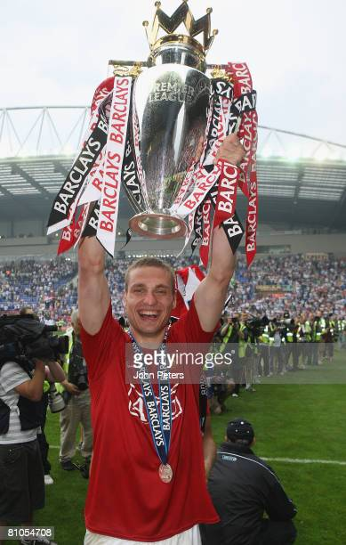 Nemanja Vidic of Manchester United celebrates with the Premier League trophy on the pitch after the Barclays FA Premier League match between Wigan...