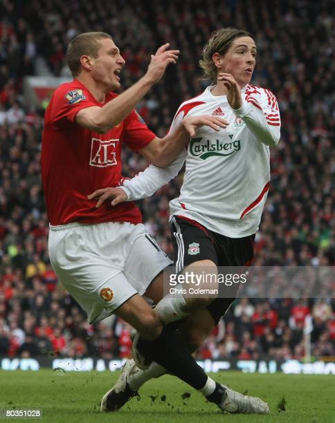 Nemanja Vidic of Manchester United clashes with Fernando Torres of Liverpool during the Barclays FA Premier League match between Manchester United...