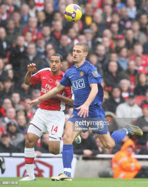 Nemanja Vidic of Manchester United clashes with Theo Walcott of Arsenal during the Barclays Premier League match between Arsenal and Manchester...