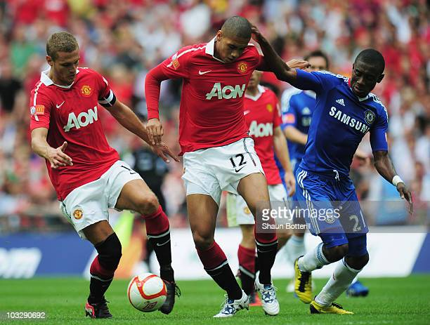 Nemanja Vidic of Manchester United collects the ball from Chris Smalling after he loses the ball under pressure by Salomon Kalou of Chelsea during...