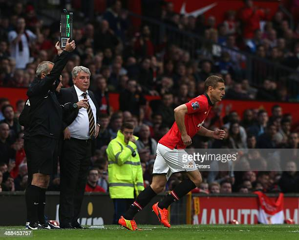 Nemanja Vidic of Manchester United comes on as a substitute for his last match as a United player during the Barclays Premier League match between...
