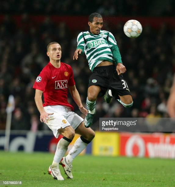 Nemanja Vidic of Manchester United competes with Liedson of Sporting Lisbon during the UEFA Champions League match between Manchester United and...