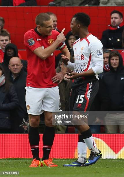 Nemanja Vidic of Manchester United complains to Daniel Sturridge of Liverpool after being sent off during the Barclays Premier League match between...