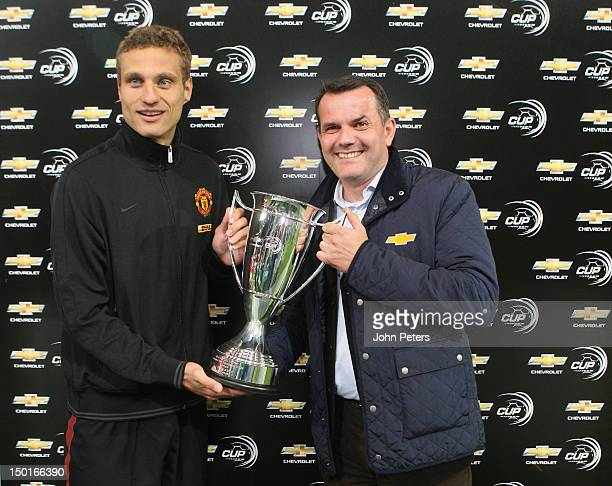 Nemanja Vidic of Manchester United is presented with the Chevrolet Cup after the pre-season friendly match between Hannover 96 and Manchester United...