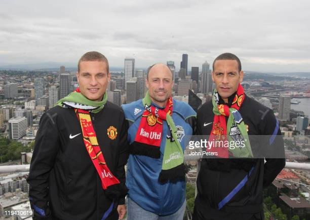 Nemanja Vidic of Manchester United Kasey Keller of Seattle Sounders and Rio Ferdinand of Manchester United perform a coin toss at the top of the...