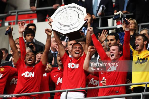 Nemanja Vidic of Manchester United lifts the Community Shield after victory in the FA Community Shield match sponsored by McDonald's between...