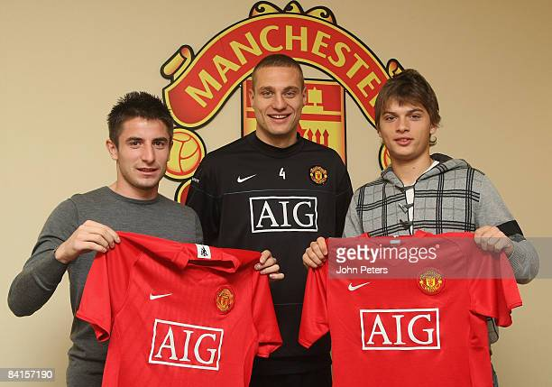 Nemanja Vidic of Manchester United poses with new Serbian signings Zoran Tosic and Adem Ljajic at Carrington Training Ground on December 11 2009 in...