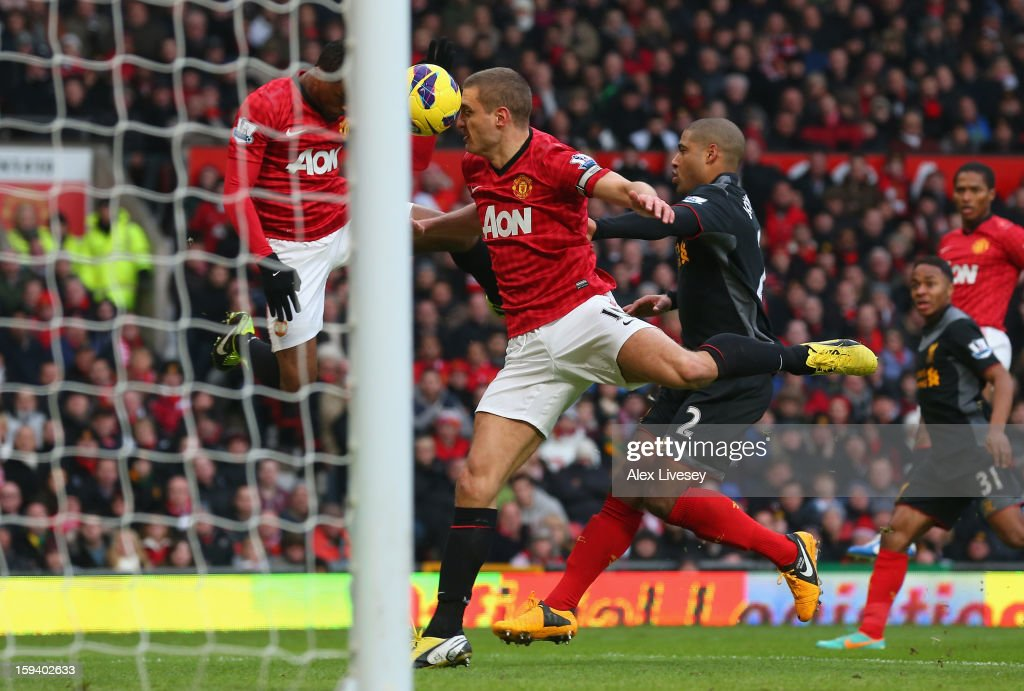 Nemanja Vidic of Manchester United scores the second goal from a deflected Patrice Evra header during the Barclays Premier League match between Manchester United and Liverpool at Old Trafford on January 13, 2013 in Manchester, England.