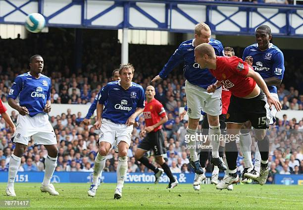 Nemanja Vidic of Manchester United scores their first goal during the Barclays Premier League match between Everton and Manchester United at Goodison...