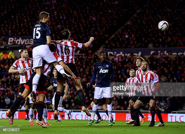 Nemanja Vidic of Manchester United scores their first goal with a header during the Capital One Cup SemiFinal first leg match between Sunderland and...