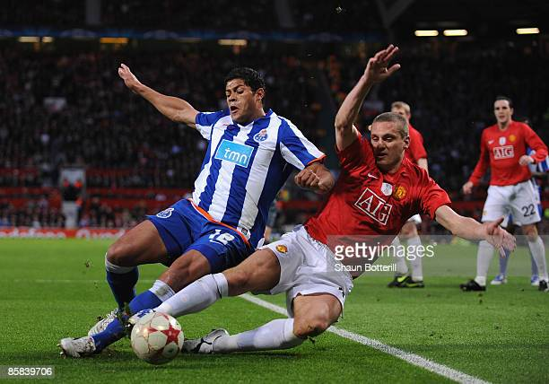 Nemanja Vidic of Manchester United tackles Hulk of FC Porto during the UEFA Champions League Quarter Final First Leg match between Manchester United...