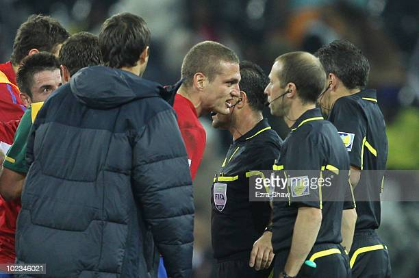 Nemanja Vidic of Serbia speaks to assistant referee Mauricio Espinosa after the 2010 FIFA World Cup South Africa Group D match between Australia and...