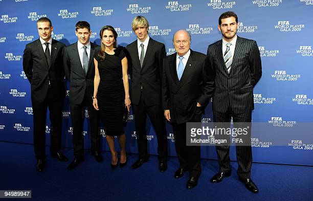 Nemanja Vidic Steven Gerrard Queen Rania of Jordan Fernando Torres FIFA President Joseph S Blatter and Iker Casillas pose for photographers as they...