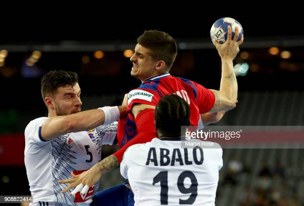 Nemanja Zelenovic of Serbia challenge Nedim Remili and Luc Abalo of France during the Men's Handball European Championship main round match between...