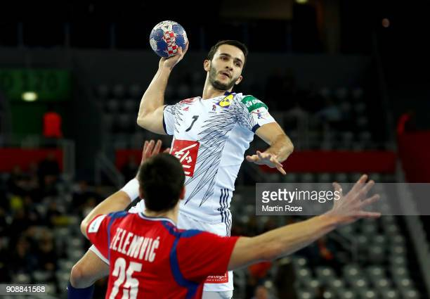Nemanja Zelenovic of Serbia challenges Romain Lagarde of France during the Men's Handball European Championship main round match between Serbia and...