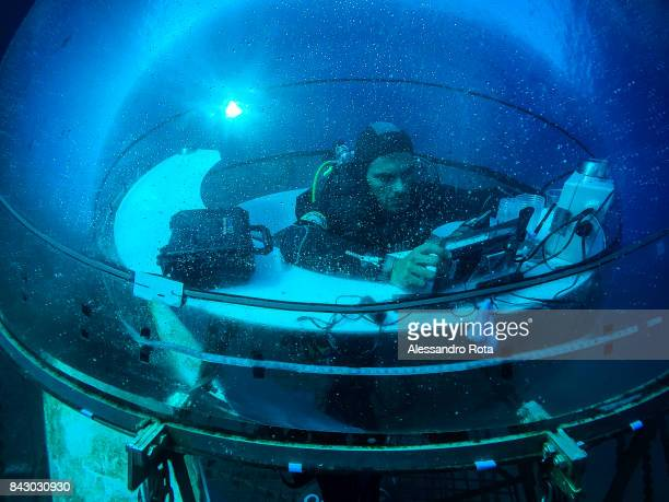 Nemo's Garden project coordinator Gianni Fontanesi is seen inside one of the six biospheres making a video call to the company HQ in Genoa on August...