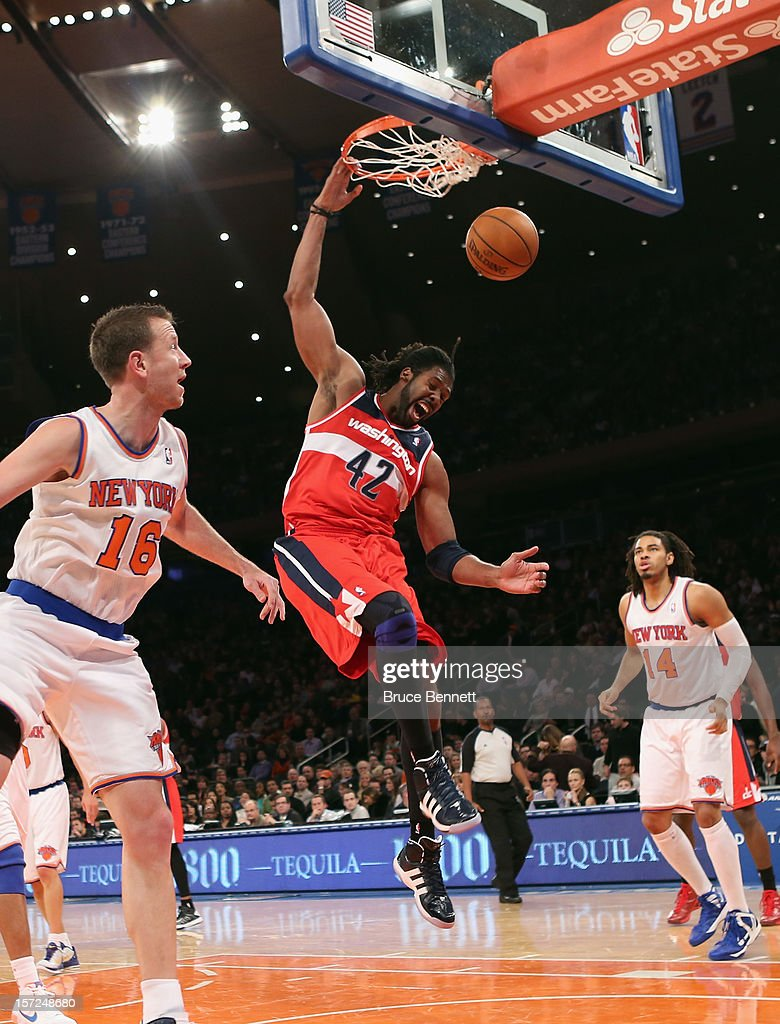 Nenê #42 of the Washington Wizards scores two against the New York Knicks in the second quarter at Madison Square Garden on November 30, 2012 in New York City.
