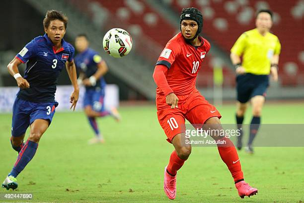 Nen Sothearoth of Cambodia and Fazrul Nawaz s/o Shahul Hameed of Singapore chase for the ball during the 2018 FIFA World Cup Qualifier Group E Match...