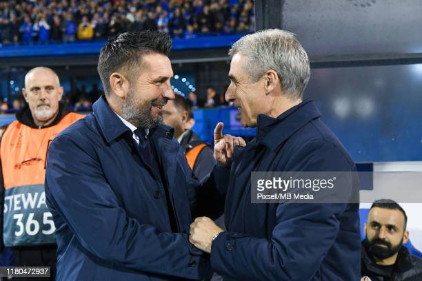 Nenad Bjelica Dinamo Zagreb team manager greets Luis Castro Shakhtar Donetsk team manager before the UEFA Champions League group C match between...