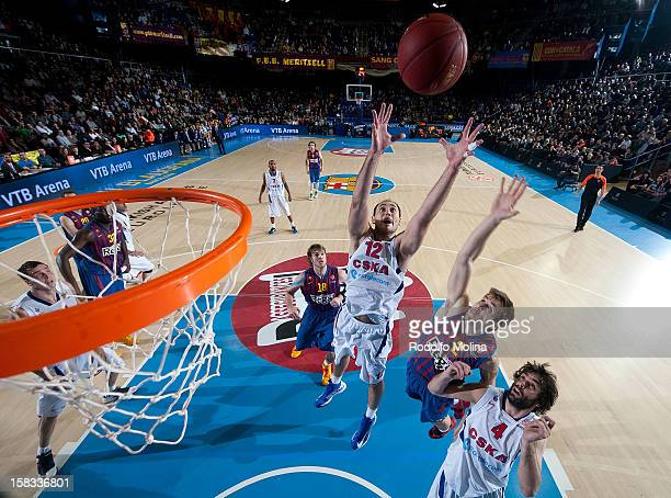 Nenad Krstic #12 of CSKA Moscow competes with Xavier Rabaseda #22 of FC Barcelona Regal during the 20122013 Turkish Airlines Euroleague Regular...