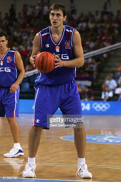 Nenad Krstic of Serbia and Montenegro gets set to shoot a free throw against Spain in a men's basketball preliminary game August 21, 2004 during the...