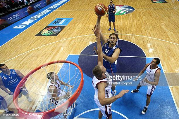 Nenad Krstic of Serbia shoots over Rolands Freimanis of Latvia during the EuroBasket 2011 first round group B match between Latvia and Serbia at...