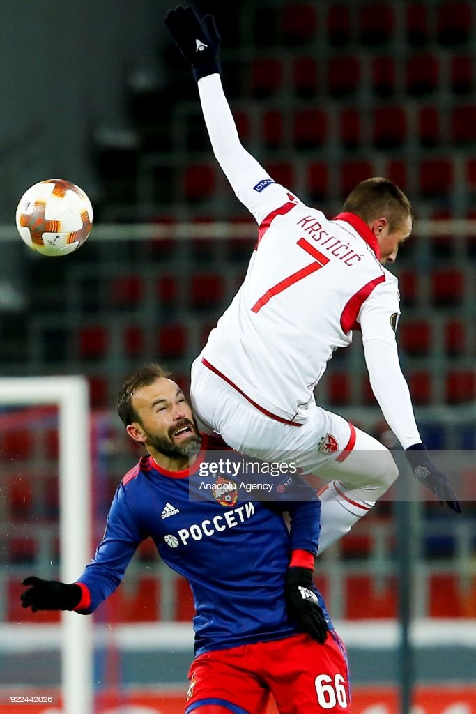Nenad Krsticic (R) of Crvena Zvezda in action against Bibras Natcho (L) of CSKA Moscow during the UEFA Europa League round of 32, second leg soccer match between CSKA Moscow and Crvena Zvezda at the Stadium CSKA Moscow in Moscow, Russia on February 21, 2018.