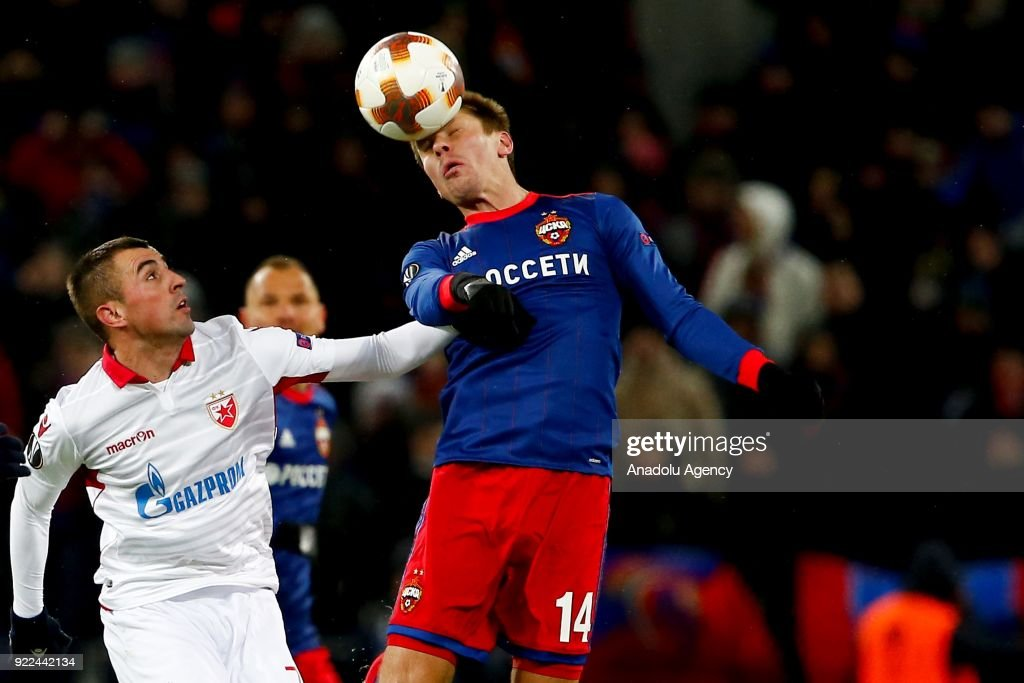 Nenad Krsticic (L) of Crvena Zvezda in action against Kirill Nababkin (R) of CSKA Moscow during the UEFA Europa League round of 32, second leg soccer match between CSKA Moscow and Crvena Zvezda at the Stadium CSKA Moscow in Moscow, Russia on February 21, 2018.