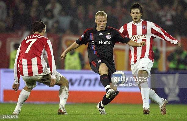 Nenad Milijas and Igor Burzanovic of Belgrade and Christian Lell of Bayern in action during the UEFA Cup group F match between Crvena Zvezda and...