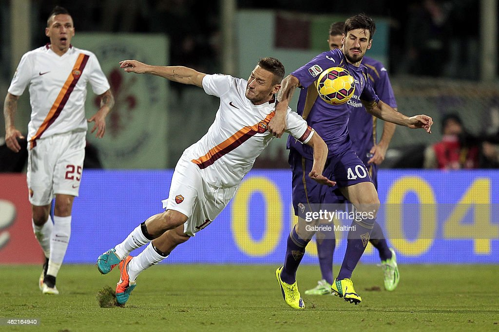 Nenad Tomovic of ACF Fiorentina battles for the ball with Francesco Totti of AS Roma during the Serie A match between ACF Fiorentina and AS Roma at Stadio Artemio Franchi on January 25, 2015 in Florence, Italy.