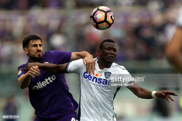 Nenad Tomovic of ACF Fiorentina battles for the ball with Mame Baba Thiam of Empoli FC during the Serie A match between ACF Fiorentina and Empoli FC...
