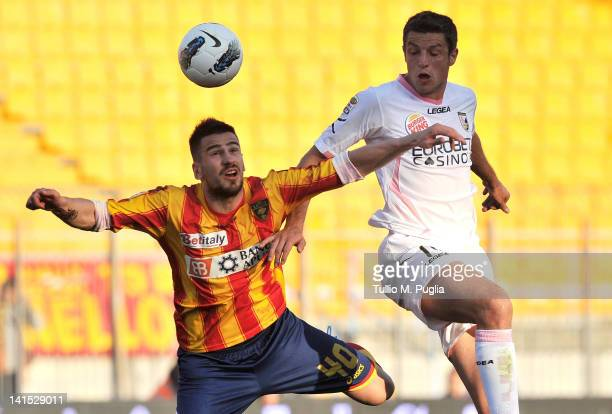 Nenad Tomovic of Lecce and Igor Budan of Palermo compete for a header during the Serie A match between US Lecce and US Citta di Palermo at Stadio Via...