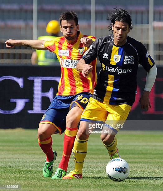 Nenad Tomovic of Lecce and Sergio Floccari of Parma in action during the Serie A match between US Lecce and Parma FC at Stadio Via del Mare on April...