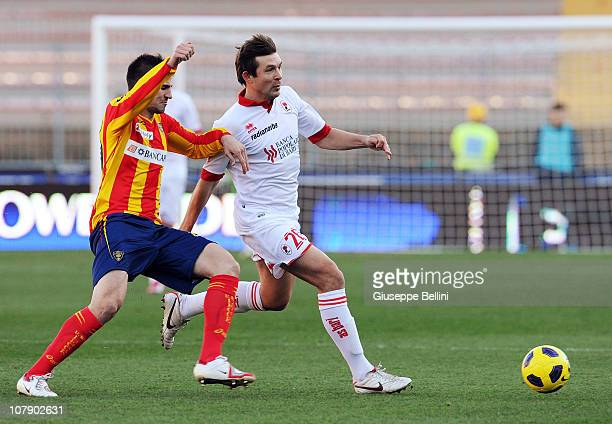 Nenad Tomovic of Lecce and Vitali Kutuzov of Bari in action during the Serie A match between Lecce and Bari at Stadio Via del Mare on January 6, 2011...