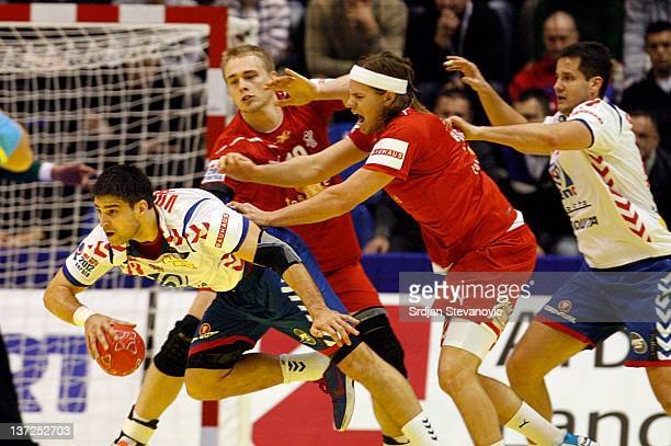 Nenad Vockovic of Serbia is fouled by Mikkel Hansen of Denmark during the Men's European Handball Championship 2012 group A match between Serbia and...
