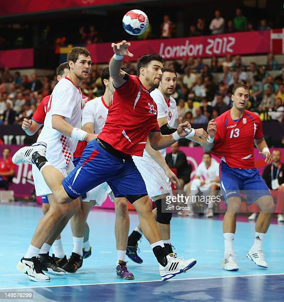 Nenad Vuckovic of Serbia shoots during the Men's Handball Preliminary match between Serbia and Croatia on Day 4 of the London 2012 Olympic Games at...