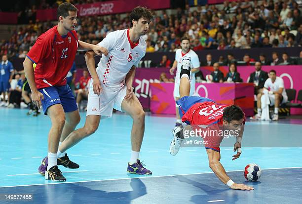 Nenad Vuckovic of Serbia trips during the Men's Handball Preliminary match between Serbia and Croatia on Day 4 of the London 2012 Olympic Games at...