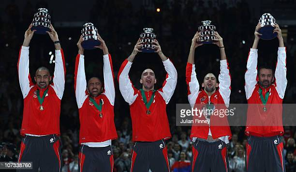 Nenad Zimonjic Janko Tipsarevic Viktor Troicki Novak Djokovic Bogdan Obradovic of Serbia celebrate with their trophies after defeating France during...