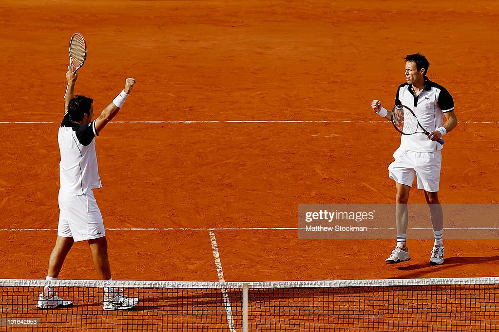 Nenad Zimonjic of Serbia and Daniel Nestor of Canada celebrate match point against Lukas Dlouhy of the Czech republic in the the doubles final on day fourteen of the French Open at Roland Garros on June 5, 2010 in Paris, France.