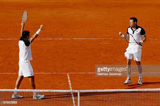 Nenad Zimonjic of Serbia and Daniel Nestor of Canada celebrate match point against Lukas Dlouhy of the Czech republic in the the doubles final on day...
