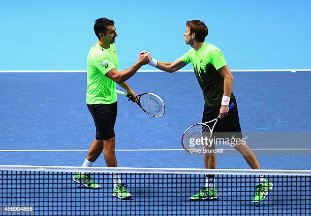 Nenad Zimonjic of Serbia and Daniel Nestor of Canada celebrate match point in the round robin doubles match against Marcel Granollers of Spain and...