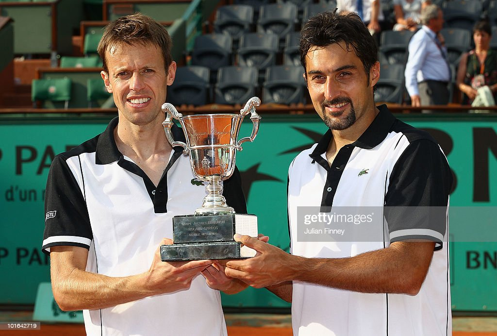 Nenad Zimonjic (R) of Serbia and Daniel Nestor of Canada celebrate with the trophy after their match against Lukas Dlouhy of the Czech Republic and Leander Paes of India in the the doubles final on day fourteen of the French Open at Roland Garros on June 5, 2010 in Paris, France.